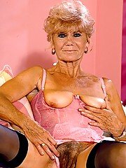 Corseted blonde granny spreading her furry fanny