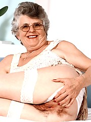 Grandma Carol takes the time out to spread her pussy lips wide wearing her white sheer stockings