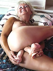 Hot granny Marcial takes out her huge dildo and traps it between her huge tits