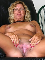 Tanned grandma spreading her pink pussy lips wide to show her sweet fuck hole