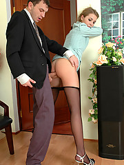 Lewd female co-worker in black pantyhose getting into mood to have anal sex