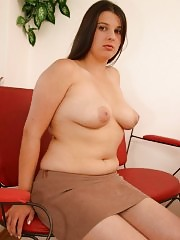 Chubby secretary getting naked in office