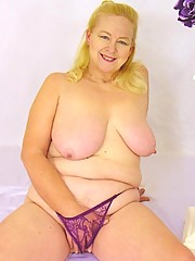 Blonde plump granny poses in purple nightie