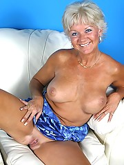 Tanned granny Marcial gives a great show in the living room with her huge round tits hanging out