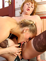 Aging lesbian dipping her tongue into fresh slit aching for the same treat