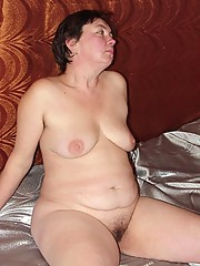 Hot granny Joana is lounging around in nothing but her white panties and giving us a great show