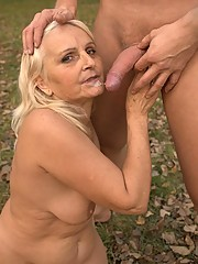 Sex starved granny Mandy riding a big wick and crams it into her gash by grinding on top