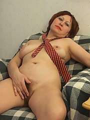Horny redhead granny stripping down into nothing but her red striped necktie