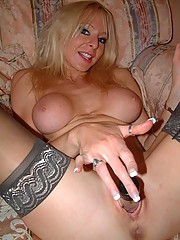 Hot granny Michelle is proud of her huge firm tits and plays around with her pussy here