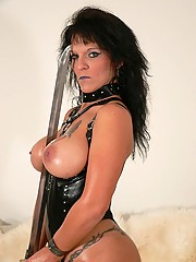 Nasty big tit granny in leather playing with her sword with her huge tits hanging out