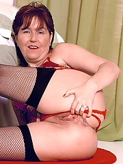 Naughty granny Jessica dresses up in her cami and sheer stockings to show off her hot body