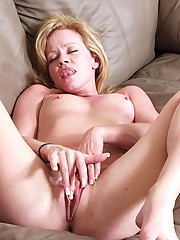 Blonde granny Jessica finger fucks her hot snatch in the living room