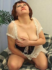 Plump grandma takes the time out to play with her hungry pussy and knead her huge tits